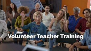 Woman raising hand in class. Volunteer Teacher Training.