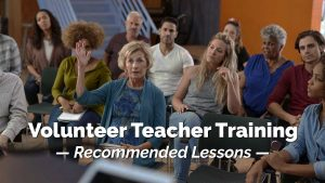 Woman raising hand in class. Volunteer Teacher Training. Recommended Lessons.