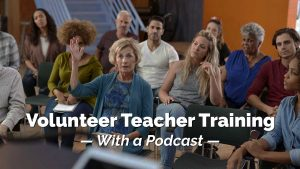 Woman raising hand in class. Volunteer Teacher Training with a podcast